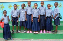 Watoto in their first school uniforms
