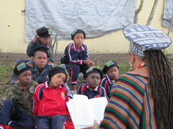 Mama C reading to the kids