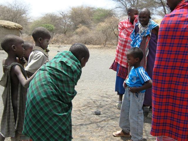 Joshua breaks the ice in the Maasai village