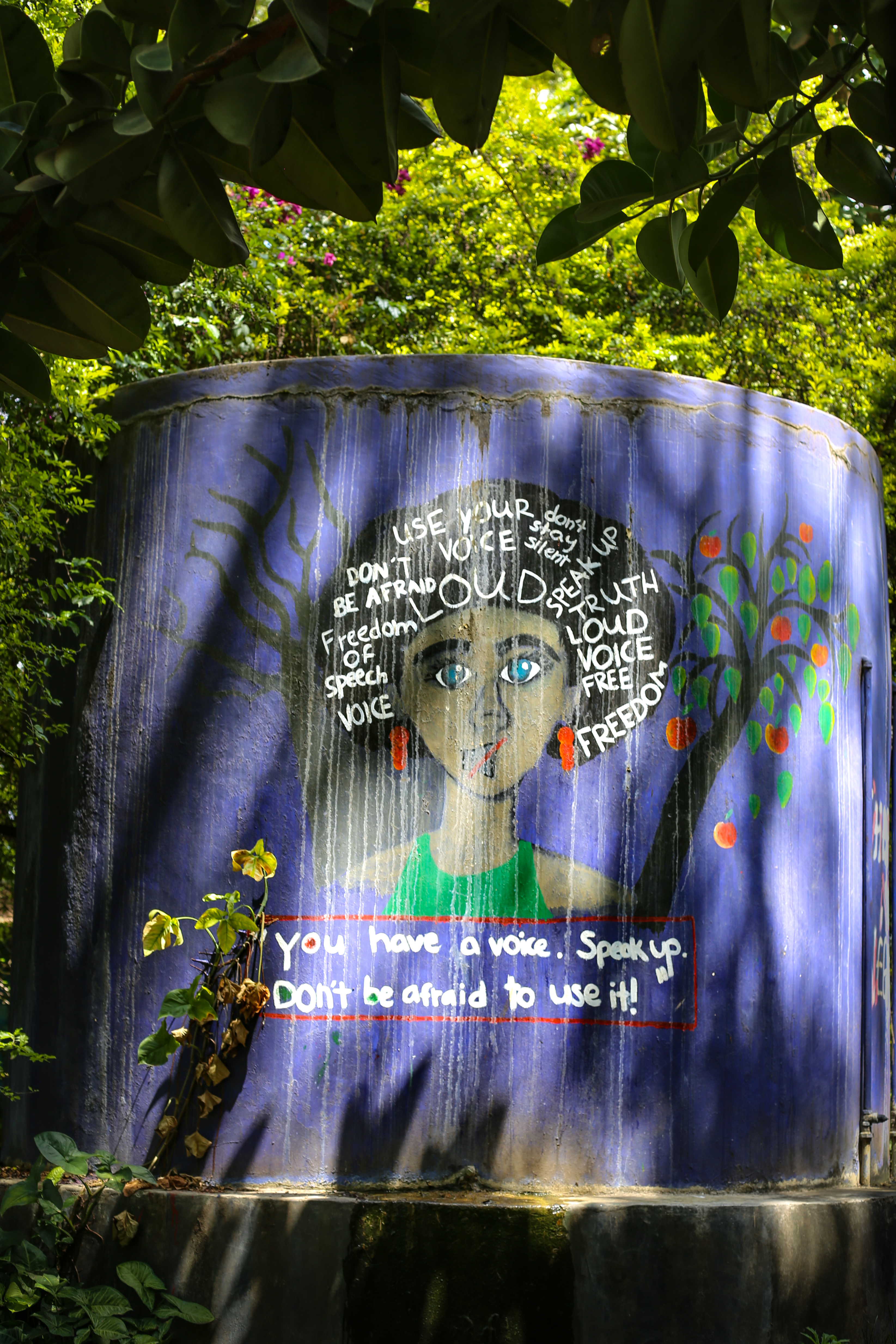 Empowerment mural on water tank at UAACC