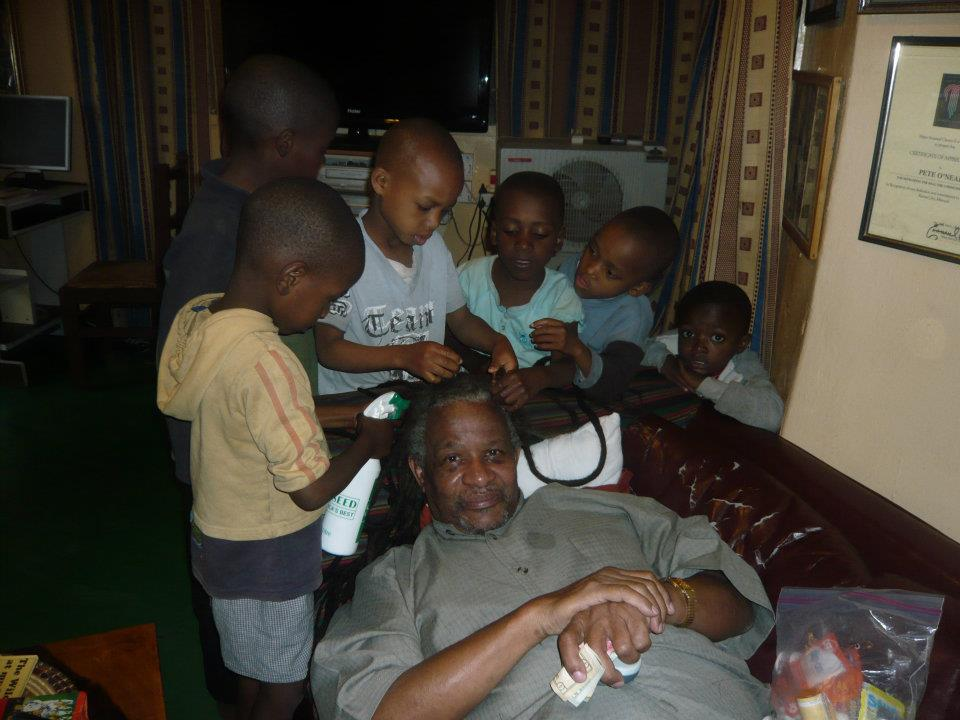 The watoto helping Babu with his hair