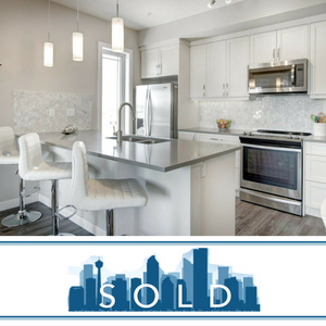 Sold sign over condo photo