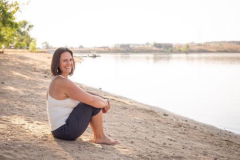Happy life wellness coach sitting on beach