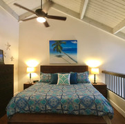 King bed, Balinese Furnishings in loft bedroom.