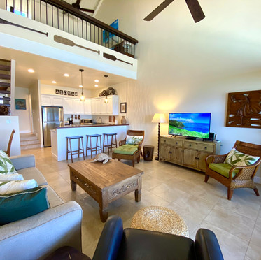 Spacious open plan living area with vaulted ceiling.