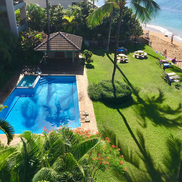 View of pool and spa from the lanai.  Look for the turtle on the beach!