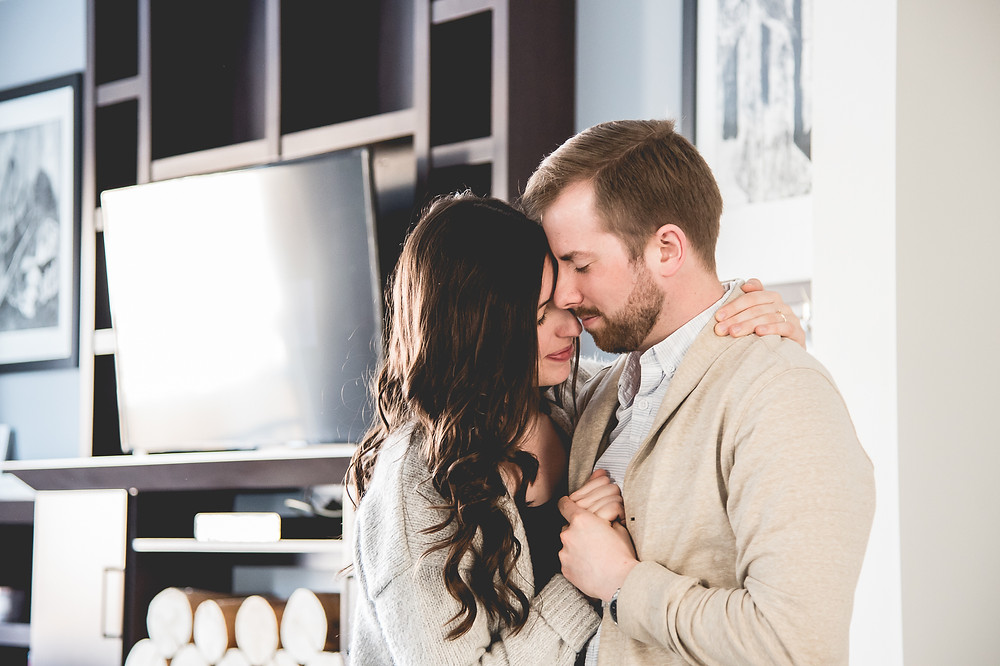 Couple embracing in a dance with eyes closed and completely in love.