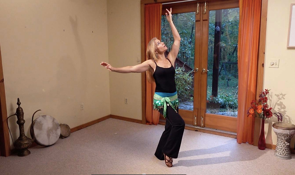 Jensuya practicing belly dance at home in makeshift home studio.