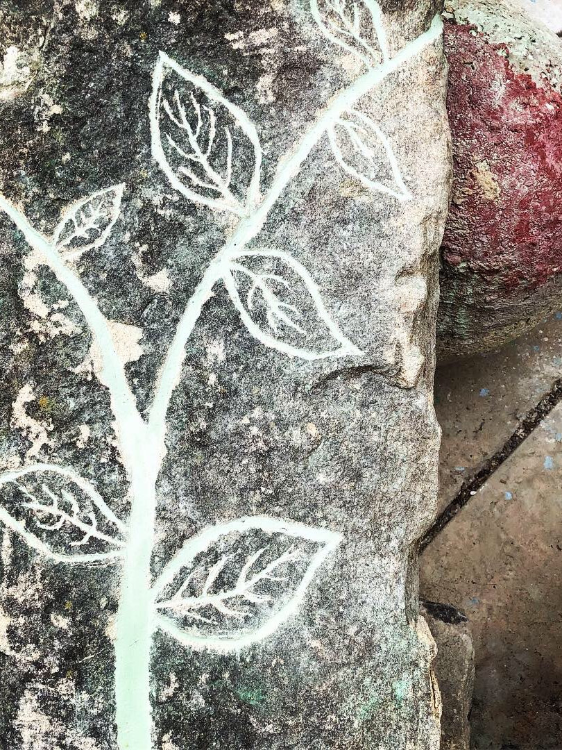 Carved stone with branch and leaves design