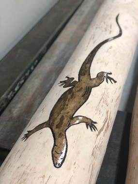 Carved timber totem with goanna design - Oiling in progress