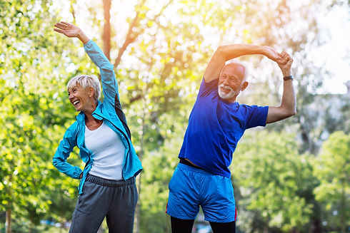 Happy fit senior couple exercising in pa