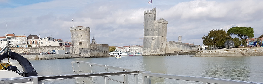 The towers guarding the Old Port of La Rochelle : an architect living and loving this city