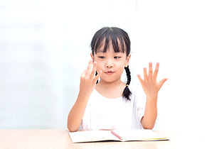Asian%20little%20Chinese%20Girl%20doing%20mathematics%20by%20counting%20fingers%20at%20hom