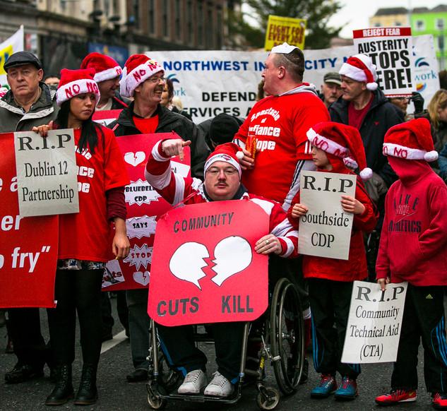 Derry Gori  on wheelchair with  friends.