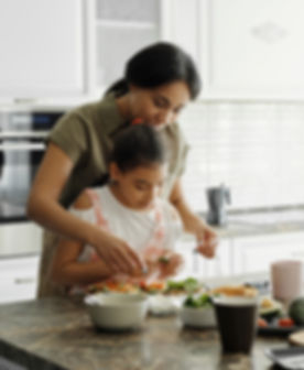 mother-and-daughter-preparing-avocado-to