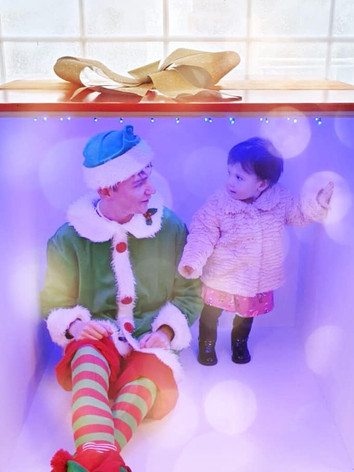 Debating with the elf about who is the most cheeky in our Instagram present photobooth.