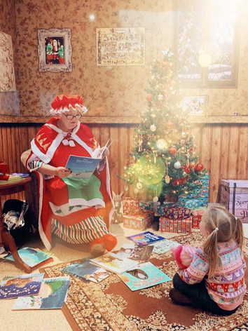 Hearing Christmas stories with Mrs Claus.
