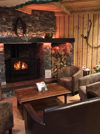 Have festive drinks and Christmas cakes by the fire in Stables Coffee Bar.