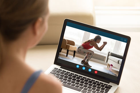 Focus on laptop screen with young woman