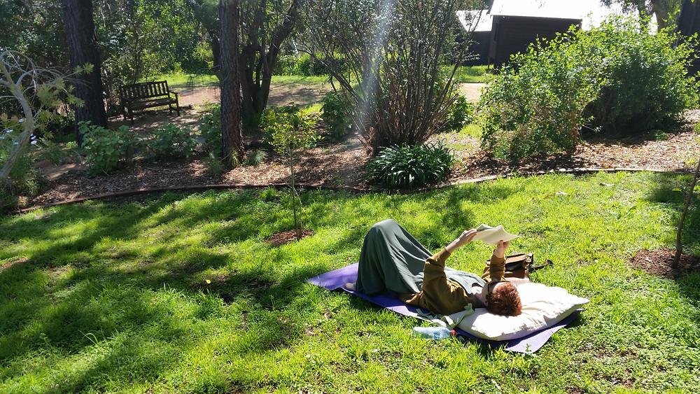 Tanya Vavilova enjoying a good read and the sunshine in the KSP garden
