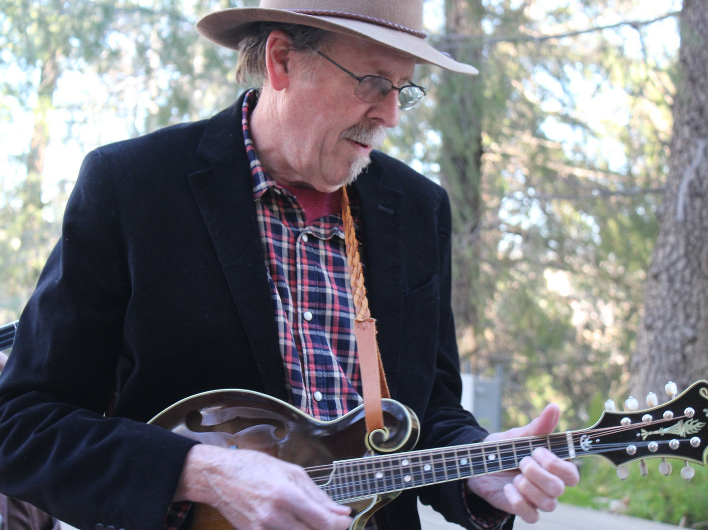 Jerry Kinkade showing off on his Wilson Mandolin made by Craig.