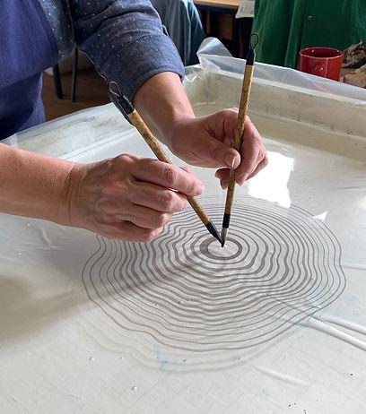 Sarah Amatt crafting suminagashi art
