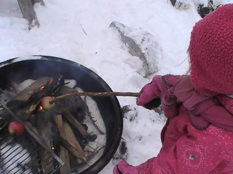 Cooking snacks over fire.