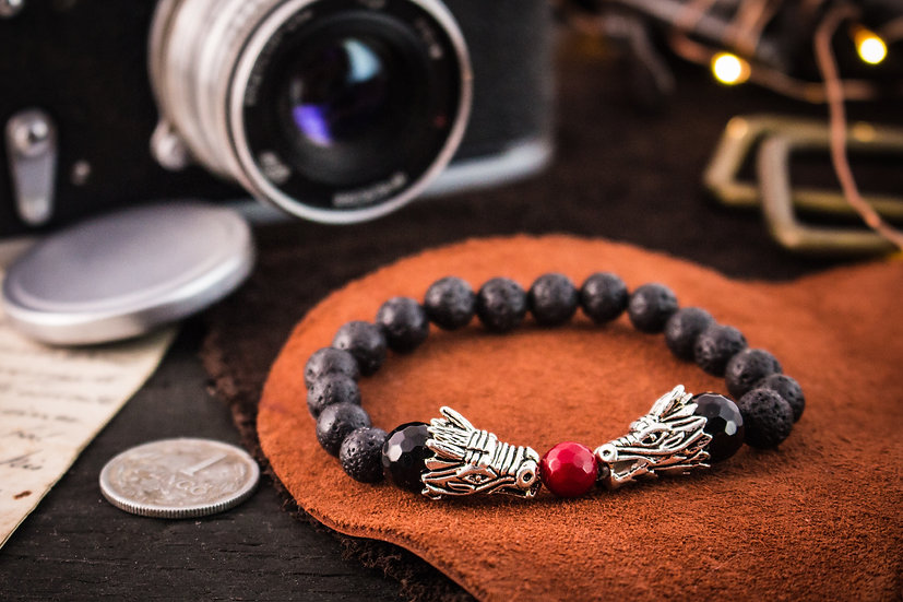 Black lava stone beaded stretchy bracelet with silver dragons