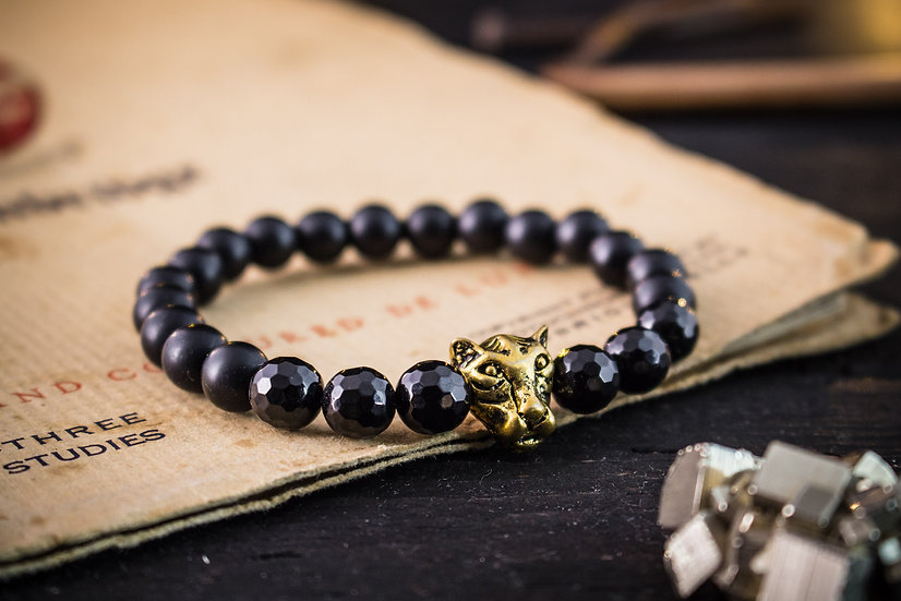 Matte black onyx beaded stretchy bracelet with gold leopard