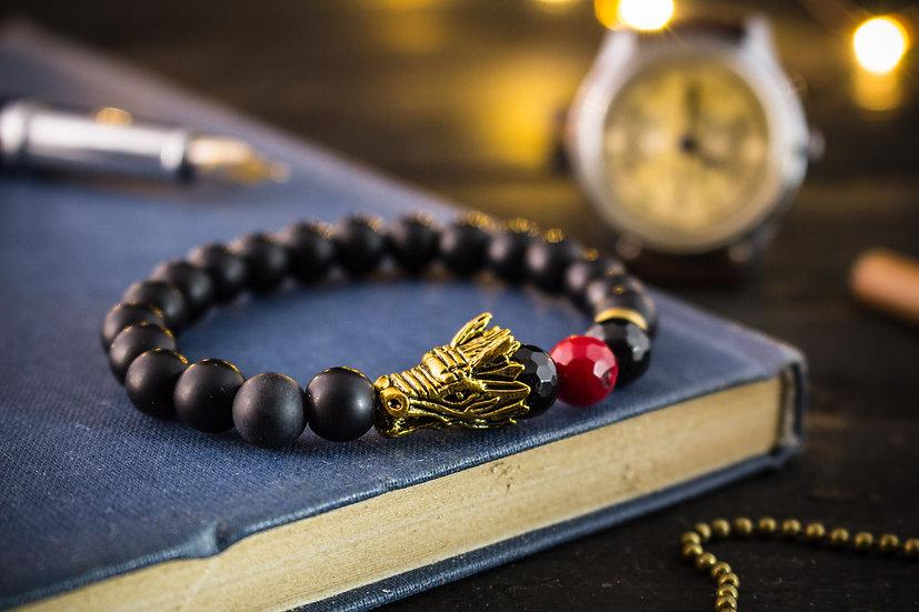 Black onyx beaded stretchy bracelet with a gold dragon