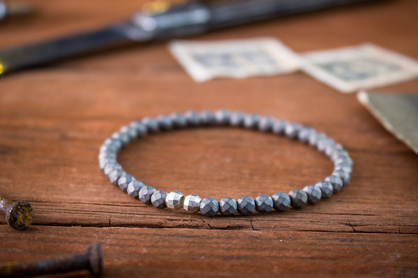 Faceted hematite beaded stretchy bracelet with sterling silver beads