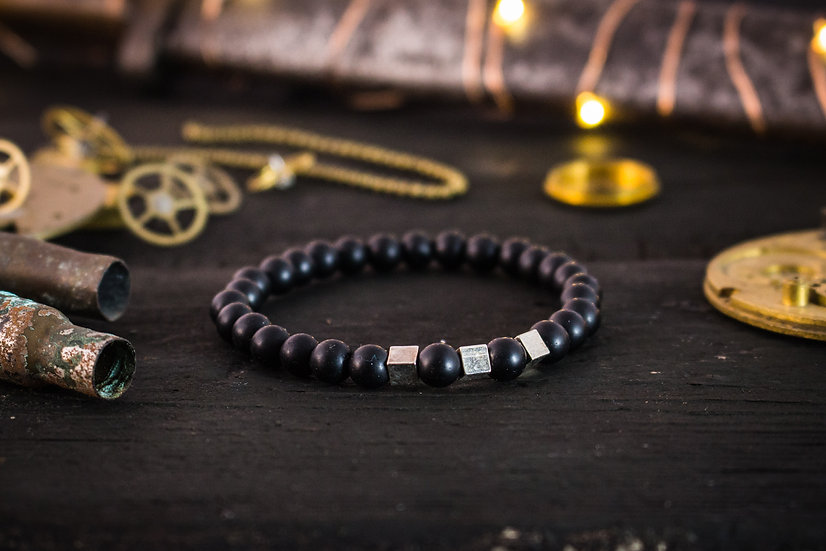Matte black onyx beaded stretchy bracelet with silver accents