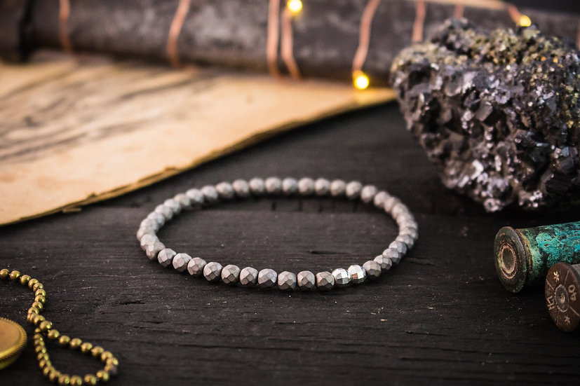 Faceted hematite beaded stretchy bracelet with sterling silver accents