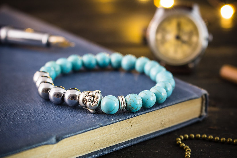 Turquoise beaded stretchy bracelet with silver smiling Buddha