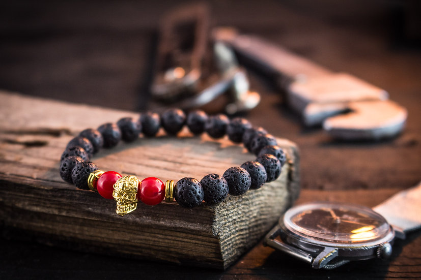 Black lava stone & red coral beaded stretchy bracelet with gold skull