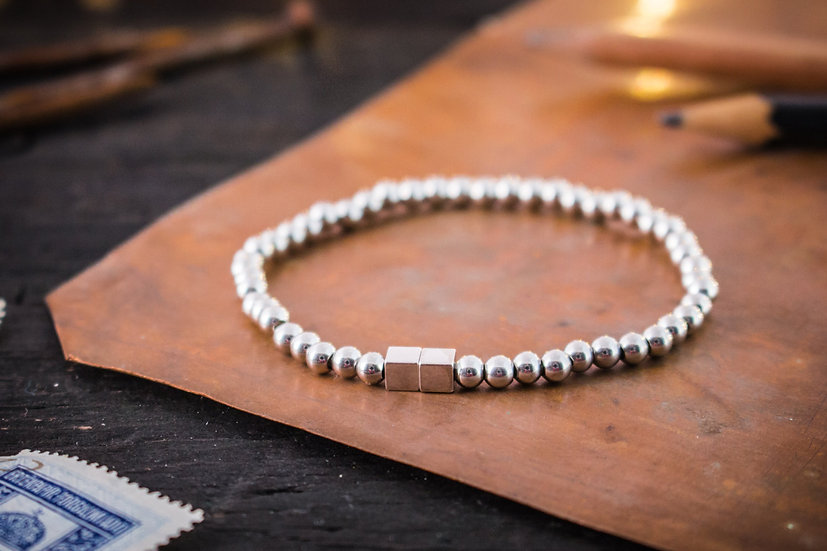 Stainless steel beaded stretchy bracelet with silver cubes