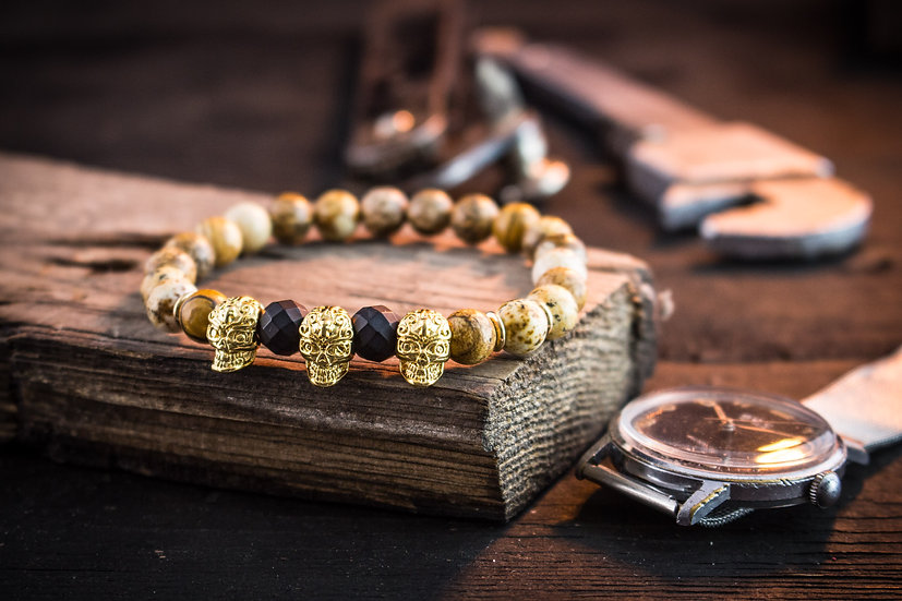 Jasper beaded stretchy bracelet with gold skulls for men