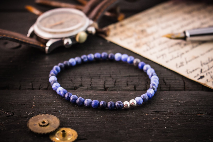 Frosted blue sodalite beaded stretchy bracelet with sterling silver accents