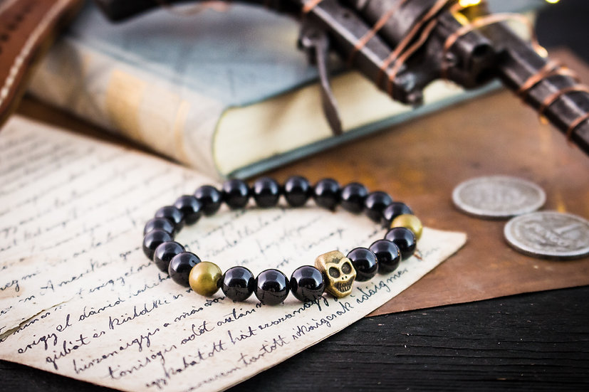 Black onyx beaded stretchy bracelet with bronze skull & accents