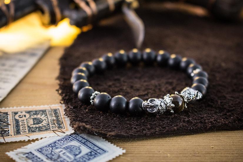Matte black onyx beaded stretchy bracelet with silver skulls