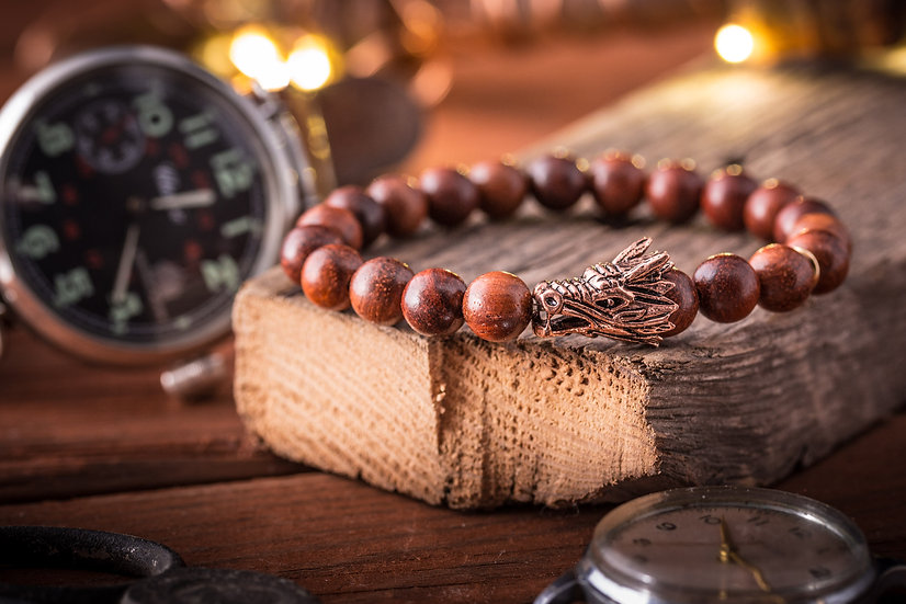 Wood beaded stretchy bracelet with rose gold Dragon charm
