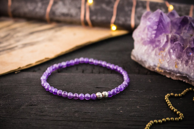 Amethyst beaded stretchy bracelet with sterling silver accents