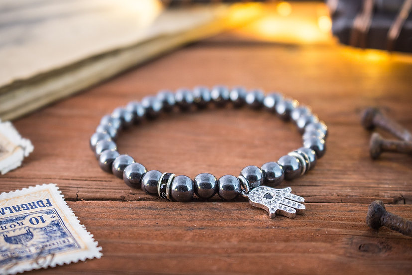 Hematite beaded stretchy bracelet with silver Hamsa hand