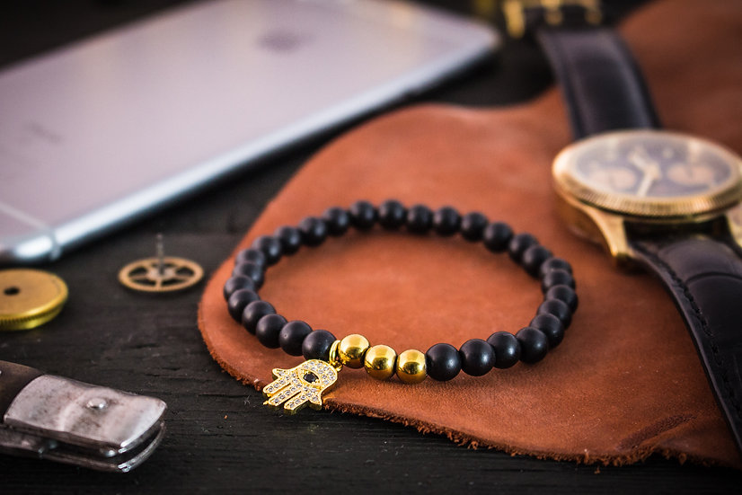 Matte black onyx beaded stretchy bracelet with gold Hamsa charm