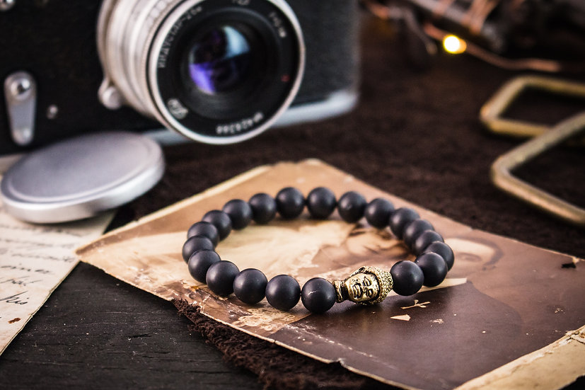 Matte black onyx beaded stretchy bracelet with gold Buddha