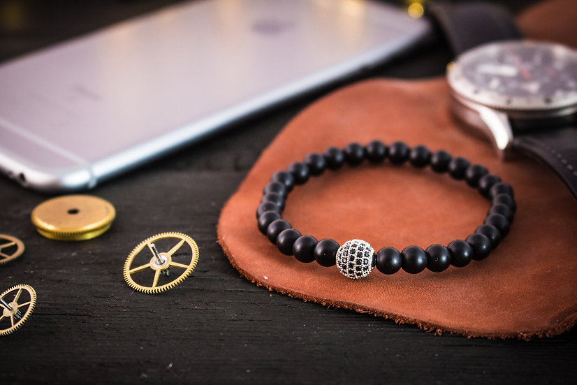 Matte black onyx beaded stretchy bracelet with silver micro pave charm