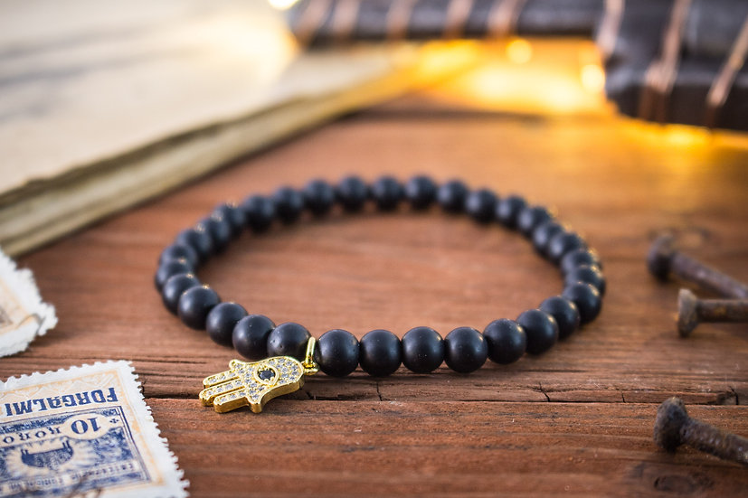 Black onyx beaded stretchy bracelet with gold Hamsa hand