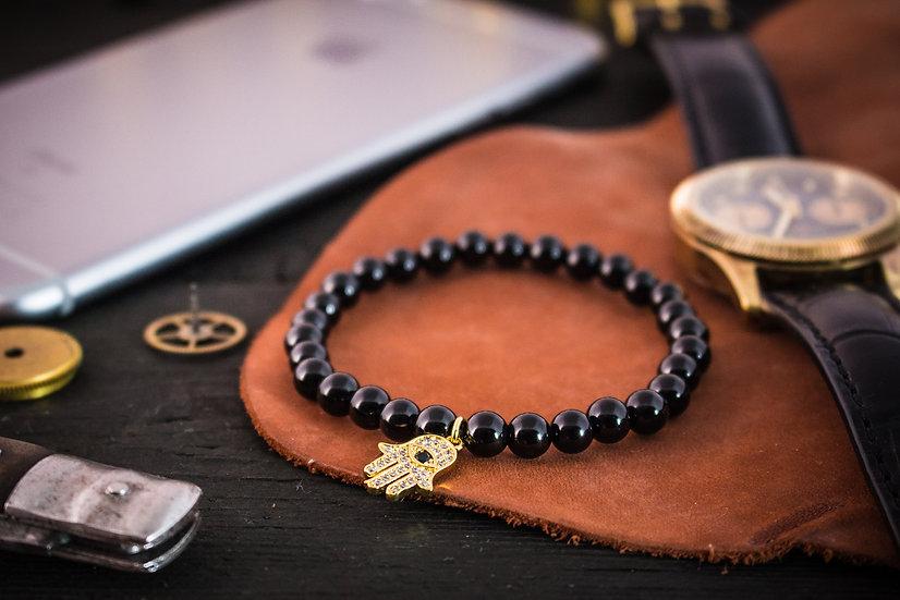 Black onyx beaded stretchy bracelet with gold Hamsa charm
