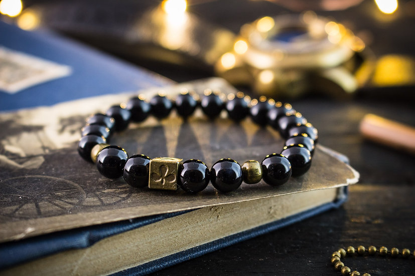 Black onyx beaded stretchy bracelet with bronze poker bead