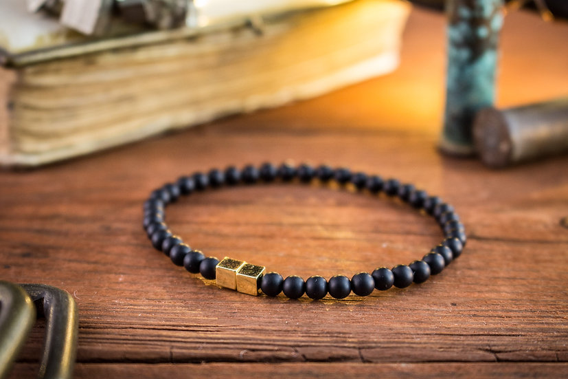 Matte black onyx beaded stretchy bracelet with gold cubes